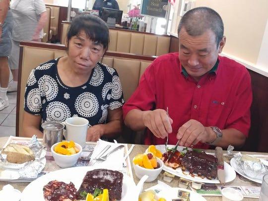 Lily's parents, QingLong Meng and ShuLan Feng, followed