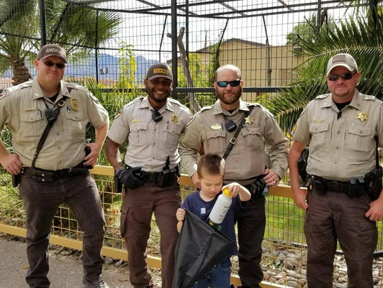 Mathias B. stands with Otero County Sheriff's Office deputies at Alameda Park Zoo on his birthday Nov. 4 in Alamogordo, N.M. The county sheriff's office celebrated Mathias' birthday after they learned no one RSVP'd to his party.