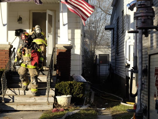 Firefighters are at the scene of a house fire in Port