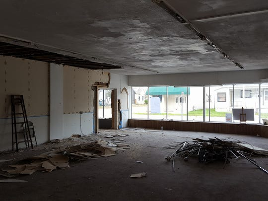Deconstruction has started inside the future Mid City Nutrition building on Griswold Sreet.