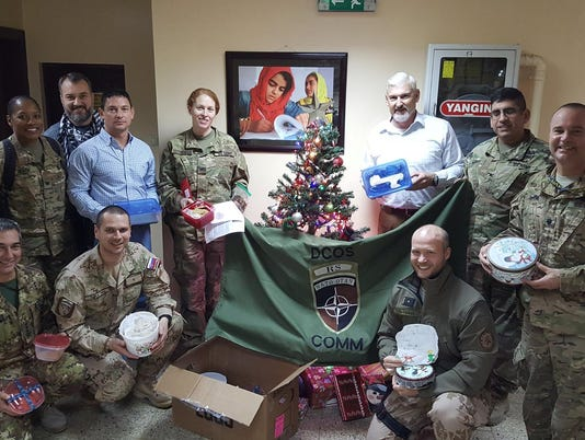 636537977960459114-Troops-who-received-Christmas-care-packages-2017-from-Operation-Yellow-Ribbon.jpg