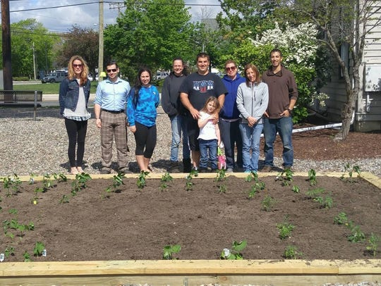 U.S. Army veteran Anthony Crincoli, center, volunteered to help establish a vegetable garden at a nonprofit veterans help organization, Vetwork of Forked River.