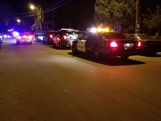 Authorities respond to a shooting Monday night in Ventura.