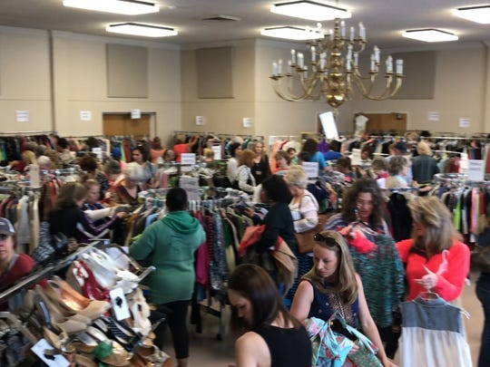 The first few hours of the Faith Fashion Boutique, a benefit for Faith Refuge, saw scores of people and brisk sales. Hundreds came through the resale event that raised almost $75,000.
