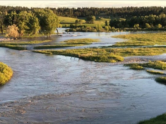 This shows the Musselshell River Wednesday night near Egge Road, prior to Thursday's flooding.