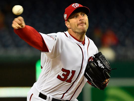 Max Scherzer currently leads the NL in wins, strikeouts