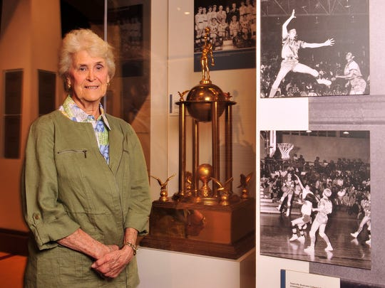 Judy Coble played for Nashville Business College from 1959-1965 and stands next to the team's national championship trophy at the Tennessee Sports Hall of Fame on March 31, 2014.