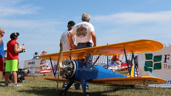 Spectators look to the skies at the Wings & Warbirds Over Port Clinton air show on Saturday.