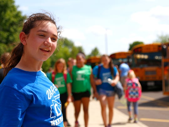 Alex Switaj keeps an eye on the 600-700 students that use the buses at Stingel Elementary on Friday afternoon. Switaj was recently chosen for the AAA school safety patrol Hall of Fame.