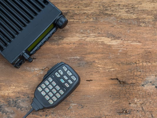 Mobile radio transceiver on Wood table