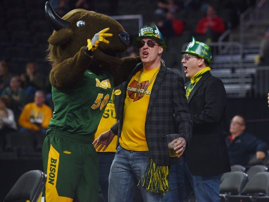 North Dakota State fans Brandon Geffre, Alan Roehrich, Robert Roehrich and Derek Hollaar celebrate a point with Thunder the mascot during the game against SDSU Saturday, March 3, during the Summit League basketball tournament at the Denny Sanford Premiere Center in Sioux Falls.