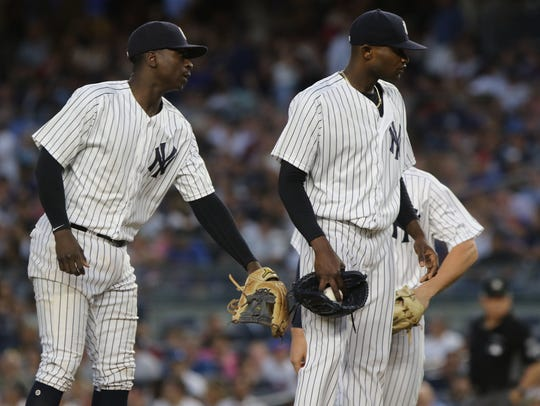 Yankee shortstop Didi Gregorius, left, encourages starting