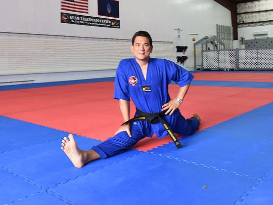 Fifth degree Taekwondo blackbelt Master Noly Caluag demonstrates the split.