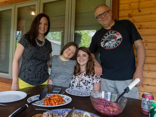 From left, Lisa, Chloe, Kyra and Bob Orvis of Glendale prepare to enjoy a meal together.