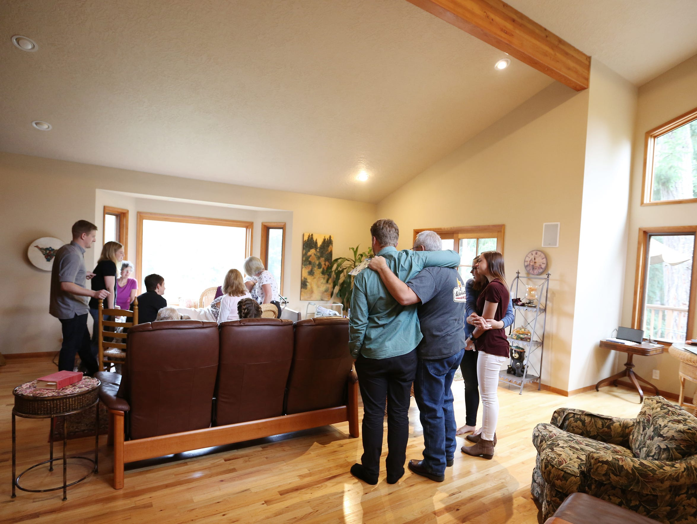 Family and friends surround Dr. Peter Rasmussen Thursday,