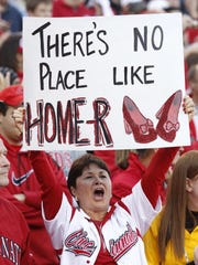 Cincinnati Reds fan Sally Heitehaus of Cleves shows her support for the Home(er) team.