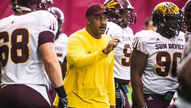 Arizona State University defensive line coach Jackie Shipp barks commands during practice inside the Verde Dickey Dome in Tempe on Monday, Aug. 10, 2015.