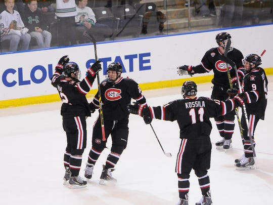 St. Cloud State players celebrate a goal by Jonny Brodzinski with 37 seconds left to tie the game during Friday's NCAA West Regional Ice Hockey Tournament.