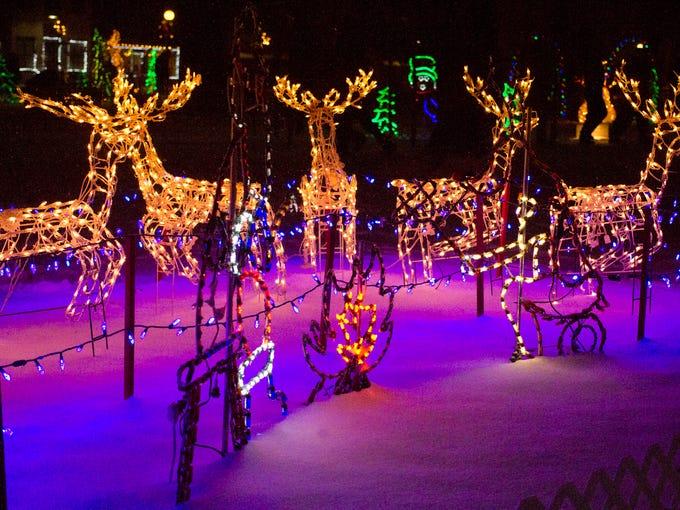 Christmas lights illuminate the snowy lawn of the LaGrange court house during the Light Up LaGrange celebration.  December 6, 2013.