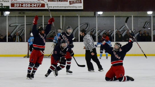 Nick Tabio (right) celebrates after scoring with 37