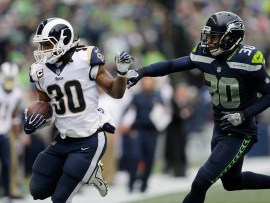 Los Angeles Rams running back Todd Gurley, left, rushes