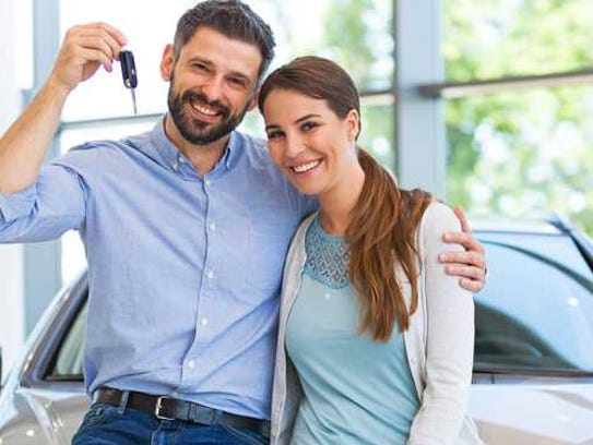 A couple buying a new car.