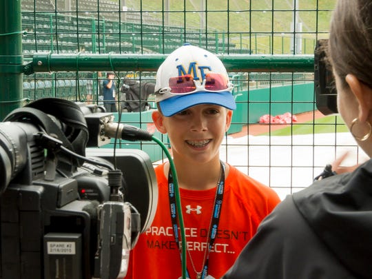 Jude Abbadessa does interviews on his 13th birthday Sunday after play was called off for the day after heavy rain at the Little League World Series in Williamsport.