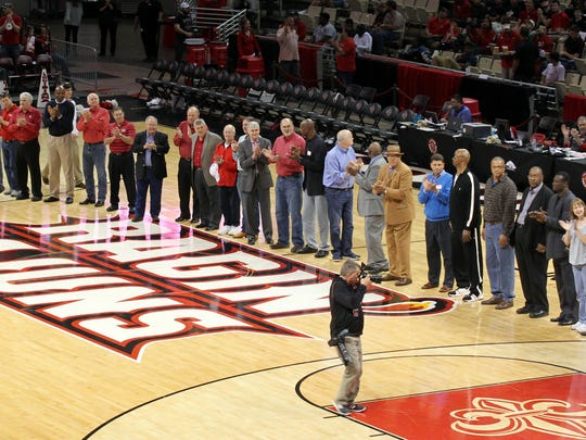 Former UL coaches, players and staff from the Paschal and Hatfield coaching era are recognized on the court during halftime as UL plays the University of Texas Arlington in an NCAA men's basketball game Saturday, February 7, 2015, at the Cajundome in Lafayette, La.