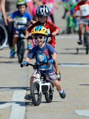 Kids take off from the start line during the free kids race of the Subway Pensacola Cycling Classic Sunday, September 17, 2017 in downtown Pensacola.