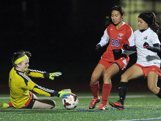 Goalie Clare Mulholland, left, was an All-Monroe County