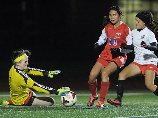 Goalie Clare Mulholland, left, was an All-Monroe County pick and second-team All-Greater Rochester last fall for Fairport, which went 15-2-1. She's one of seven returning starters for the Red Raiders, who've made it to three sectional finals in the past seven years but come up empty.