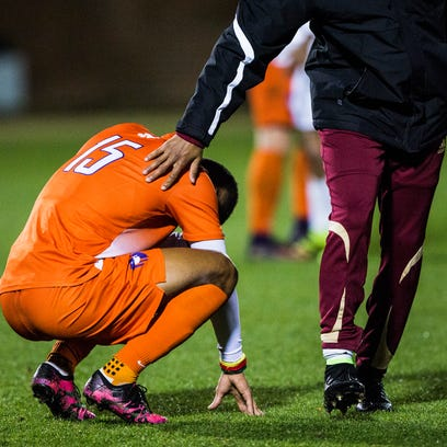 Clemson senior Alex Happi is patted on the back by