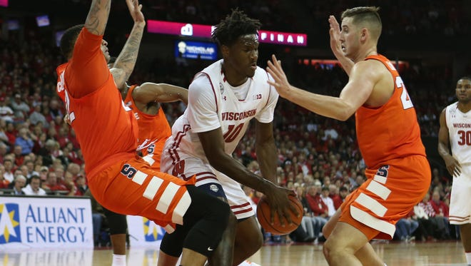 Wisconsin's Nigel Hayes (10) may have been bottled up in this sequene by DaJuan Coleman, left, and Tyler Lydon, but the senior forward was the perfect trigger man to blow up the Orange's 2-3 zone. He had 9 points, 10 assists and 11 rebounds.