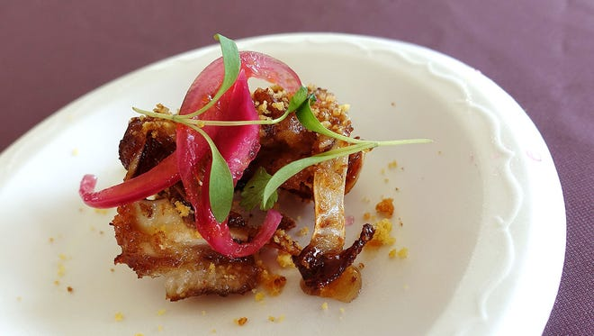 Tenderbelly crispy pig ears with bourbon honey glaze and cornbread crumble from Citizen Public House at the 2017 azcentral Food & Wine Experience.