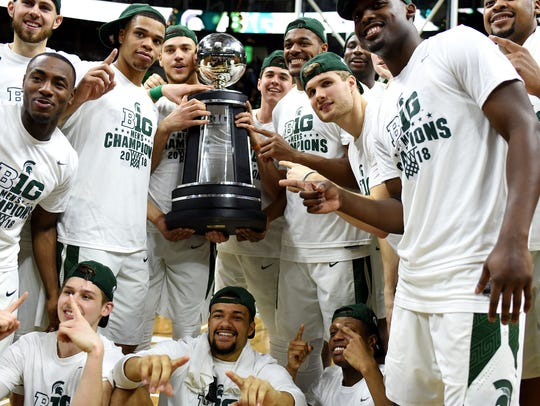 The Michigan State basketball team celebrates with