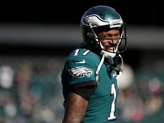 FILE - In this Sunday, Nov. 26, 2017, file photo, Philadelphia Eagles' Alshon Jeffery smiles before an NFL football game against the Chicago Bears, in Philadelphia. The Eagles have signed Jeffery to a four-year contract extension that runs through 2021. The deal announced Saturday, Dec. 2, 2017, is reportedly worth $52 million, with $27 million guaranteed. (AP Photo/Michael Perez, File)