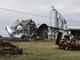 Several grain bins and oilfield storage tanks were