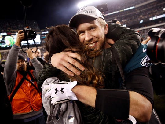 Philadelphia Eagles' Nick Foles gets a hug after the