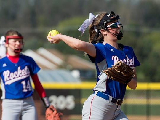 Spring Grove's Hailey Kessinger throws to first base