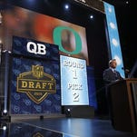 NFL Commissioner Roger Goodell announces the Titans' selection of Oregon quarterback Marcus Mariota as the second pick in the draft.