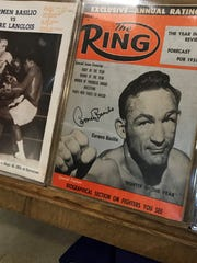 "The 1957 Ring magazine cover naming Carmen Basilio as ""Fighter of the Year"" is one of the many items that'll be on display in The Carmen Basilio Showcase at the Irondequoit Public Library through September."