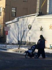 Ashley Fisher, 29, a Burlington resident, walks Monday