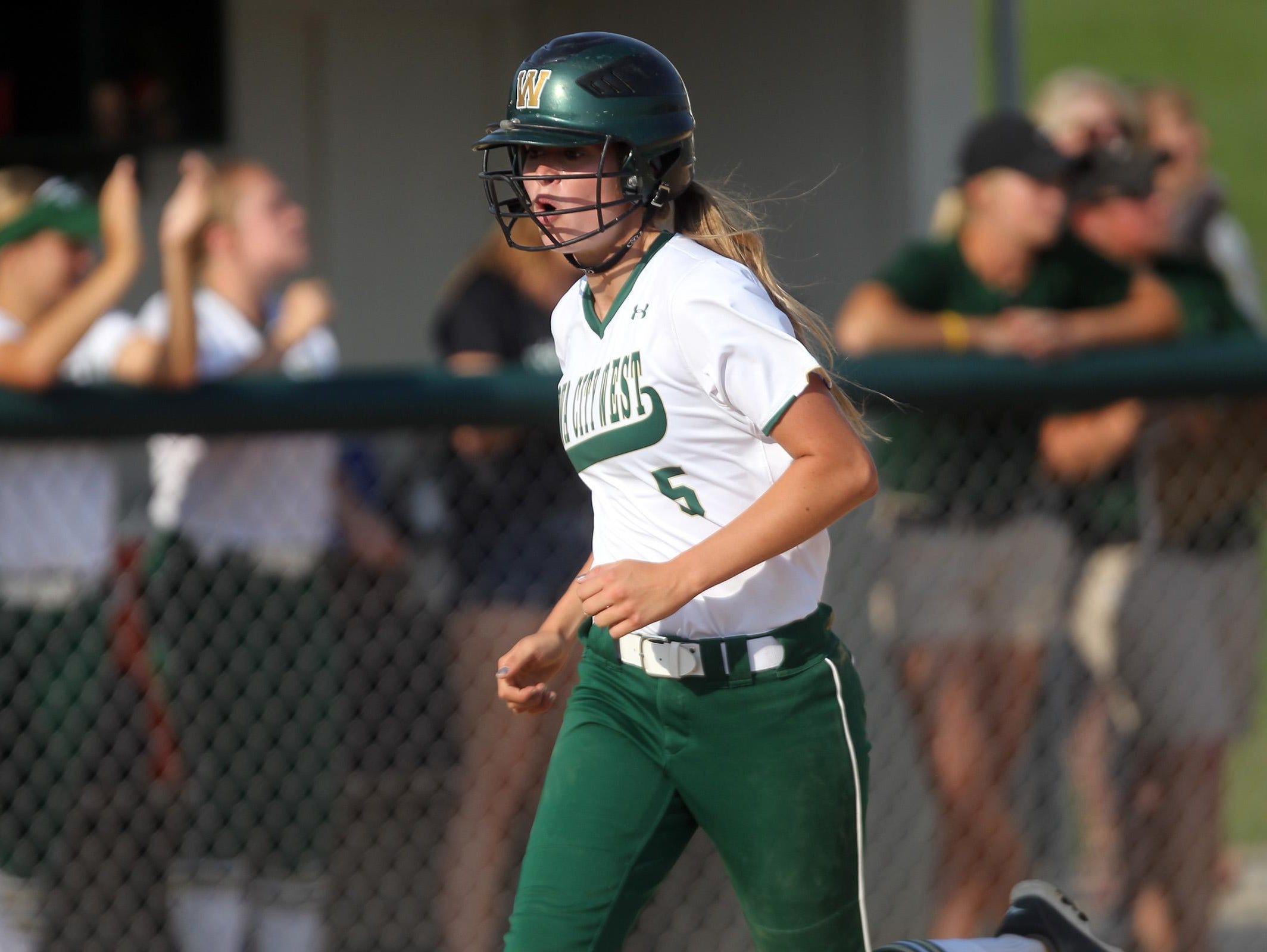 West High's Grace Tafolla celebrates as she runs in a score during the Women of Troy's game against Linn-Mar on Thursday, July 9, 2015.