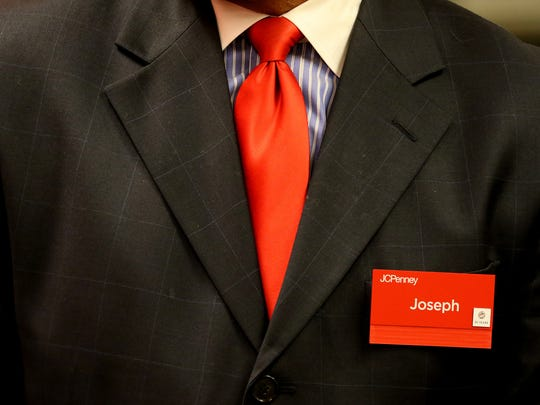 Joseph Daniel wears a suit on his last day at the JCPenney in downtown Salem on Friday, Oct. 30, 2015. Daniel is retiring after 38 years with the company.