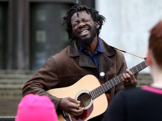 Rich McCloud performs during a One Billion Rising rally at the Oregon State Capitol in Salem on Sunday, Feb. 14, 2016. The event is part of a worldwide campaign to end violence against women and girls.
