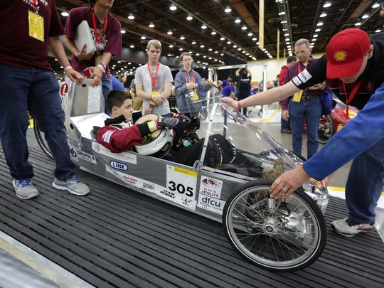University of Detroit Jesuit driver Spencer LaBuda, 16, sits in his team's car as it's brakes are being tested during technical inspection for the Shell Eco-Marathon Americas 2016 at Cobo Center in Detroit on Friday April 22, 2016.