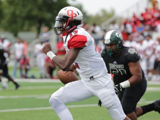 Oak Park's quarterback Dwan Mathis runs the ball by