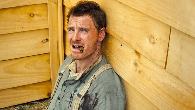 """Michael Fassbender is Silas, a grizzled bounty hunter, in """"Slow West."""""""