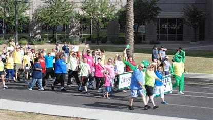 The community takes part in the NAMIWalks Valley Walk in 2014 in Phoenix.