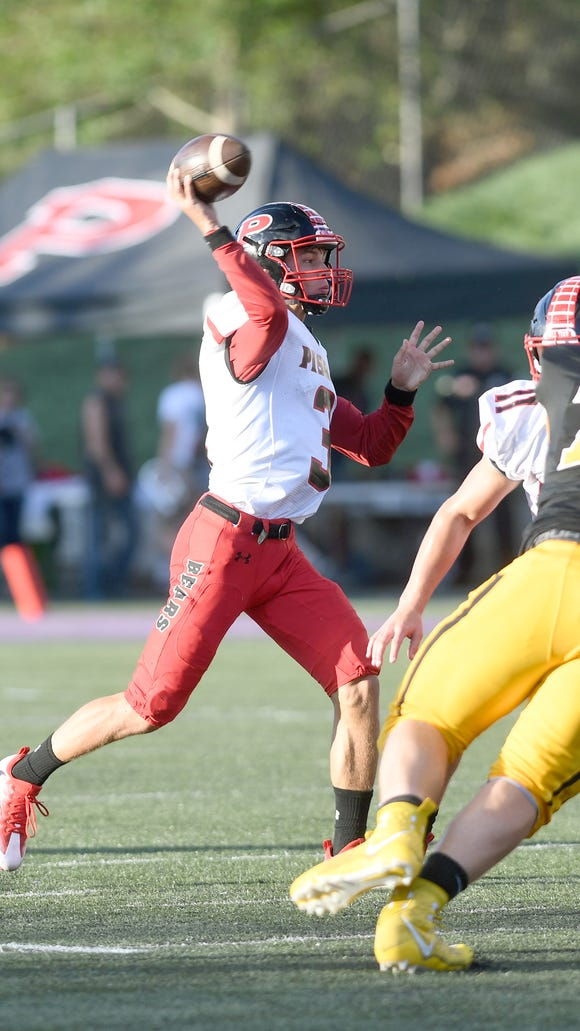 Pisgah quarterback Tanner Wike throws a pass during